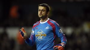 Swansea goalkeeper Lukasz Fabianski, pictured, says he is happy to stay in the Barclays Premier League despite apparent interest from Italian giants Roma