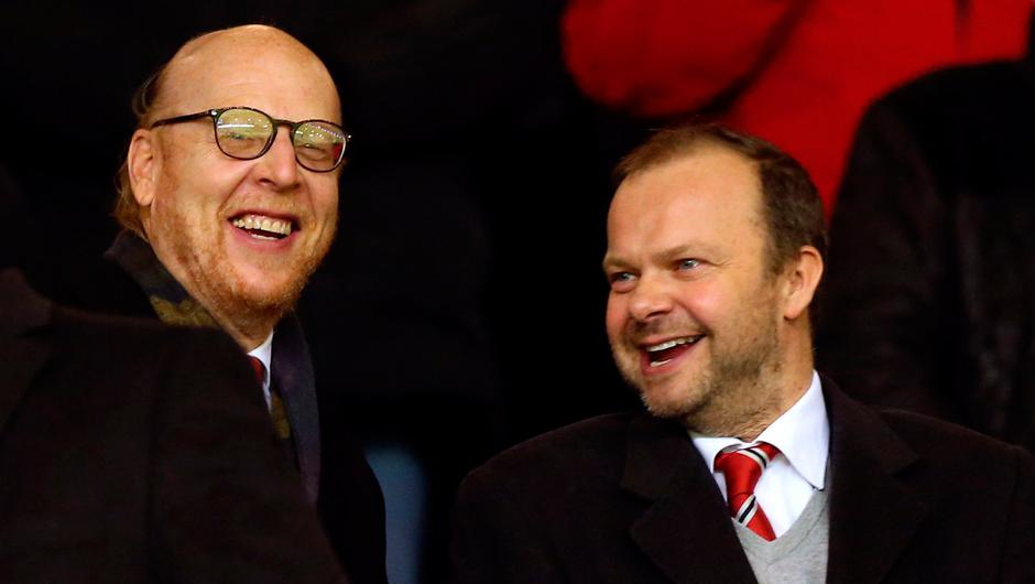Manchester United co owner Joel Glazer (left) and Executive Vice Chairman and Director Ed Woodward. Photo credit: Martin Rickett/PA Wire