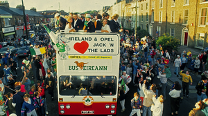 The Republic of Ireland squad are greeted by supporters as their bus makes its way through the streets of Dublin during the homecoming from Italia 90. Photo: Ray McManus