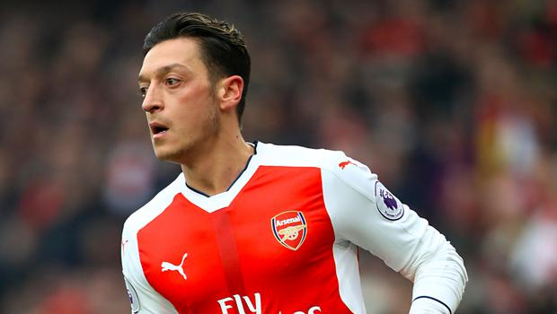 Mesut Ozil was back in action for Arsenal following a sickness bug