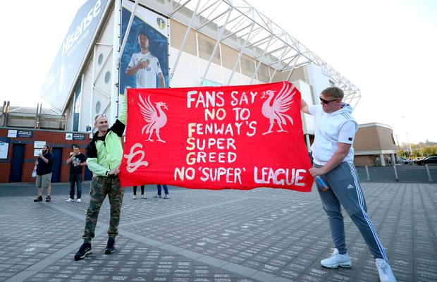 Fans protest outside Elland Road last night against Liverpool's decision to be included amongst the clubs attempting to form a new European Super League before the Premier League match.