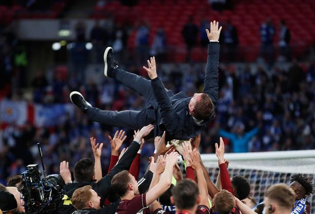 Leicester City manager Brendan Rodgers and his players celebrate winning the FA Cup at Wembley on Saturday. Photo: Matthew Childs/Reuters