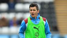 Burnley's Joey Barton is free to play at Liverpool on Sunday