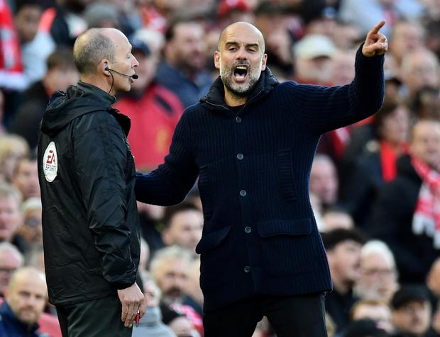 Manchester City manager Pep Guardiola, right, remonstrates with the fourth official during Sunday's game against Liverpool. Photo: Peter Powell/Reuters