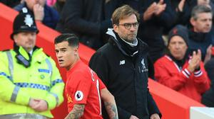 Liverpool manager Jurgen Klopp (right) is comfortable with Philippe Coutinho's inconsistent form since he returned from injury
