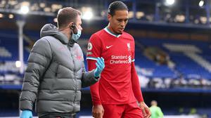 Liverpool defender Virgil Van Dijk limped out of Saturday's Merseyside derby (Laurence Griffiths/PA)