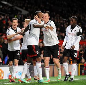 Darren Bent, centre, is mobbed by his team-mates after netting the equaliser