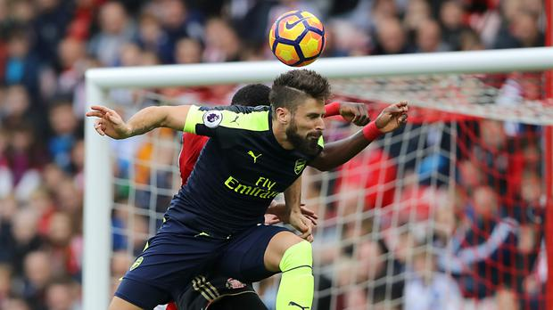 Arsenal's Olivier Giroud heads home his second goal at Sunderland