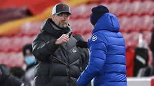 Liverpool manager Jurgen Klopp bumps fists with Chelsea manager Thomas Tuchel. Photo: Reuters/Laurence Griffiths