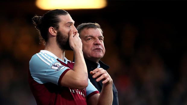 Andy Carroll, left, could miss the rest of the season through injury