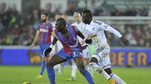 Swansea's Modou Barrow, right, scored against Tranmere in the FA Cup
