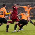 Roberto Firmino finds a way through the Wolves defence to fire Liverpool back into the lead. Photo: Reuters