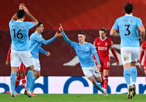 Phil Foden of Manchester City celebrates after scoring his side's fourth goal against Liverpool on Sunday. Photo: Laurence Griffiths/Getty Images