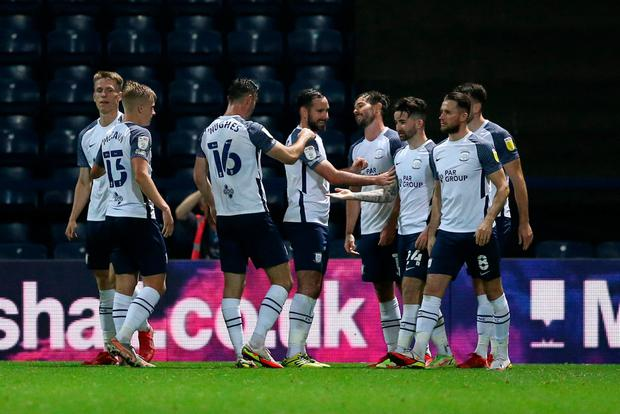 PRESTON, ENGLAND - SEPTEMBER 21: Sean Maguire of Preston North End celebrates with team mates after scoring their side's third goal during the Carabao Cup Third Round match between Preston North End and Cheltenham Town at Deepdale Stadium on September 21, 2021 in Preston, England. (Photo by Charlotte Tattersall/Getty Images)