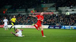 Jordan Henderson watches on as the ball loops into the Swansea net