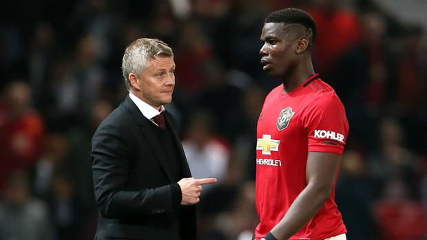 Ole Gunnar Solskjaer (left) says Paul Pogba will not be leaving Manchester United next month (Richard Sellers/PA)