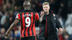 Bournemouth manager Eddie Howe, right, celebrates with goalscorer Benik Afobe