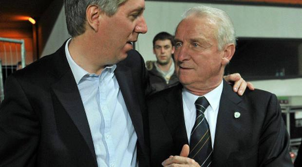 FAI chief executive John Delaney celebrates with Republic of Ireland manager Giovanni Trapattoni after Ireland's first leg victory over Estonia in the Euro 2012 play-off