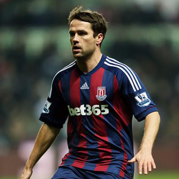 Michael Owen, pictured, and Mikel Arteta clashed during Stoke's defeat to Arsenal on Saturday