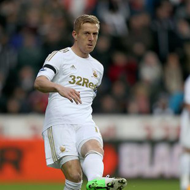 Garry Monk will stay with Swansea until 2015