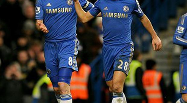Chelsea's Frank Lampard (left) celebrates scoring his teams third goal of the game with teammate Cesar Azpilicueta (right) during the Barclays Premier League match at Stamford Bridge, London. PRESS ASSOCIATION Photo. Picture date: Saturday February 9, 2013. See PA story SOCCER Chelsea. Photo credit should read: Andrew Matthews/PA Wire. RESTRICTIONS: Editorial use only. Maximum 45 images during a match. No video emulation or promotion as 'live'. No use in games, competitions, merchandise, betting or single club/player services. No use with unofficial audio, video, data, fixtures or club/league logos.