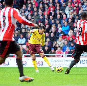 Arsenal's Santi Cazorla scores during the Barclays Premier League match at the Stadium of Light, Sunderland. PRESS ASSOCIATION Photo. Picture date: Saturday February 9, 2013. See PA story SOCCER Sunderland. Photo credit should read: Owen Humphreys/PA Wire. RESTRICTIONS: Editorial use only. Maximum 45 images during a match. No video emulation or promotion as 'live'. No use in games, competitions, merchandise, betting or single club/player services. No use with unofficial audio, video, data, fixtures or club/league logos.