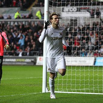 Swansea City's Miguel Michu celebrates scoring his side's first goal of the game during the Barclays Premier League match at the Liberty Stadium, Swansea. PRESS ASSOCIATION Photo. Picture date: Saturday February 9, 2013. See PA story SOCCER Swansea. Photo credit should read: Nick Potts/PA Wire. RESTRICTIONS: Editorial use only. Maximum 45 images during a match. No video emulation or promotion as 'live'. No use in games, competitions, merchandise, betting or single club/player services. No use with unofficial audio, video, data, fixtures or club/league logos.