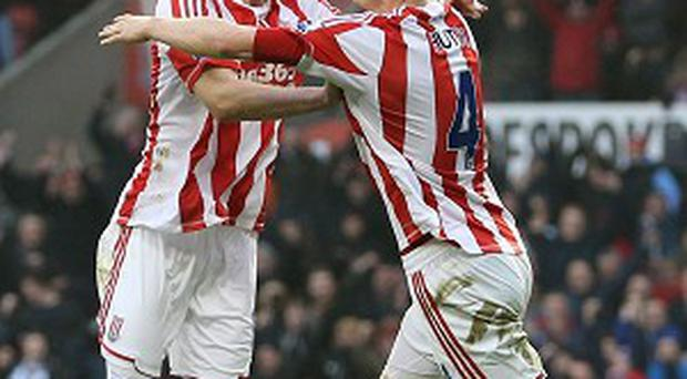 Stoke City's Ryan Shawcross celebrates with goalscorer Robert Huth as they celebrate the opening goal during the Barclays Premier League match at the Britannia Stadium, Stoke-on-Trent. PRESS ASSOCIATION Photo. Picture date: Saturday February 9, 2013. See PA story SOCCER Stoke. Photo credit should read: Dave Thompson/PA Wire. ESTRICTIONS: Editorial use only. Maximum 45 images during a match. No video emulation or promotion as 'live'. No use in games, competitions, merchandise, betting or single club/player services. No use with unofficial audio, video, data, fixtures or club/league logos.