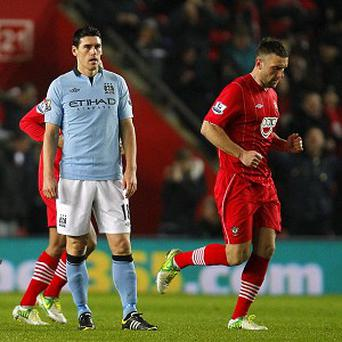 Manchester City's Gareth Barry (left) appears dejected after scoring an own-goal and Southampton's third during the Barclays Premier League match at St Marys' Stadium, Southampton. PRESS ASSOCIATION Photo. Picture date: Saturday February 9, 2013. See PA story SOCCER Southampton. Photo credit should read: Chris Ison/PA Wire. RESTRICTIONS: Editorial use only. Maximum 45 images during a match. No video emulation or promotion as 'live'. No use in games, competitions, merchandise, betting or single club/player services. No use with unofficial audio, video, data, fixtures or club/league logos.