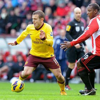 Jack Wilshere, left, was subject to a few hefty challenges from Sunderland's players