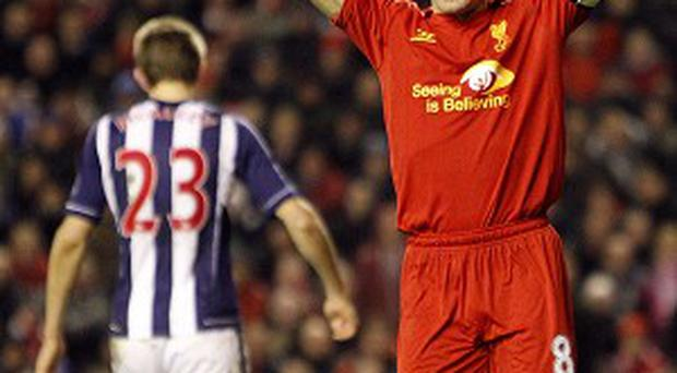 Liverpool's Steven Gerrard, right, rues his missed penalty against West Brom
