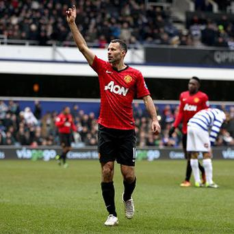Rafael and Ryan Giggs, pictured, scored a goal apiece at QPR