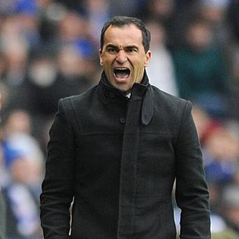 Roberto Martinez's Wigan claimed a much-needed victory over Reading