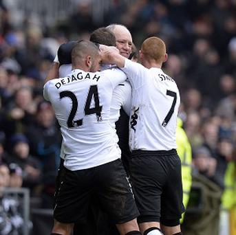 Dimitar Berbatov celebrated with Martin Jol, centre, after scoring with a volley against Stoke