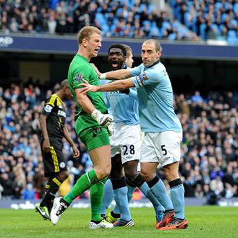 Goalkeeper Joe Hart, left, celebrates after saving Frank Lampard's penalty