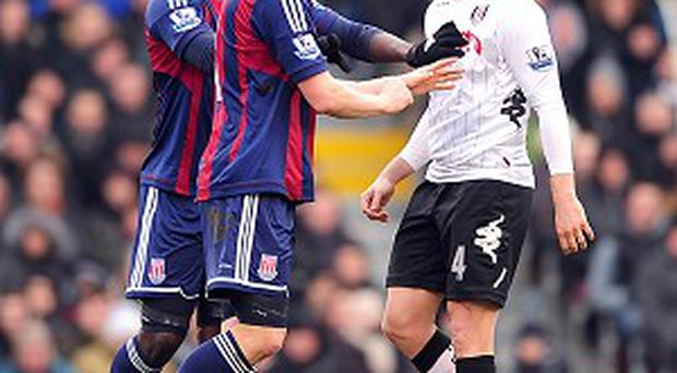 Robert Huth, centre, caught Fulham defender Philippe Senderos, right, in the face with his forearm