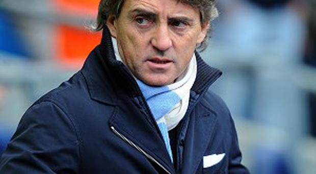 Roberto Mancini has not given up on the title race