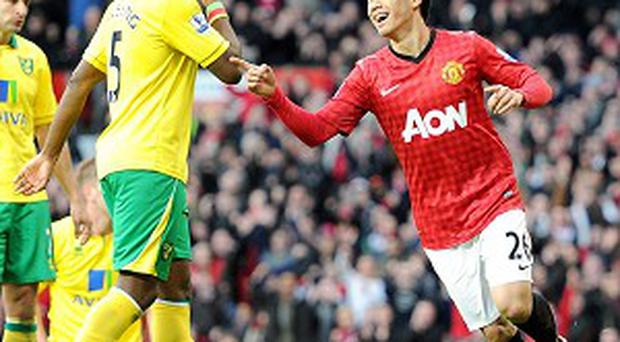Shinji Kagawa, right, bagged a hat-trick as Manchester United eased past Norwich