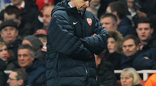 Arsene Wenger insisted he was unconcerned by rumours of a buy-out of Arsenal