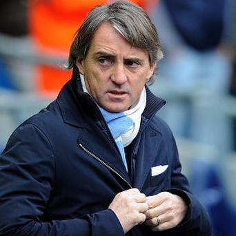 Roberto Mancini's Manchester City sit 12 points behind neighbours United in the Barclays Premier League