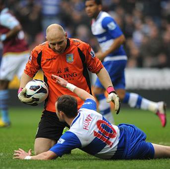 Noel Hunt, bottom, said '(Brad Guzan) just punched me in the back of the head and got the ball'