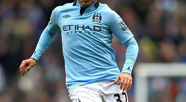 Carlos Tevez charged with driving while disqualified and without insurance