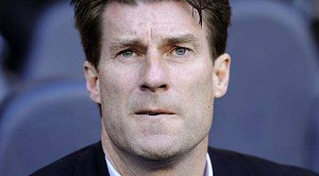 Michael Laudrup insists the pressure will be on Arsenal this weekend