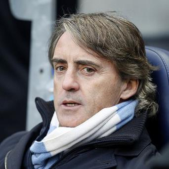 Roberto Mancini has not given up hope of Manchester City retaining their title