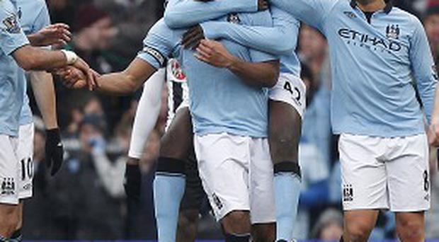 Carlos Tevez, David Silva and Vincent Kompany, centre, were on target against Newcastle