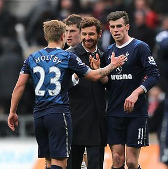 Andre Villas-Boas, centre, praised Gareth Bale's, right, performance at Swansea