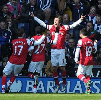Tomas Rosicky, centre right, bagged a brace for Arsenal