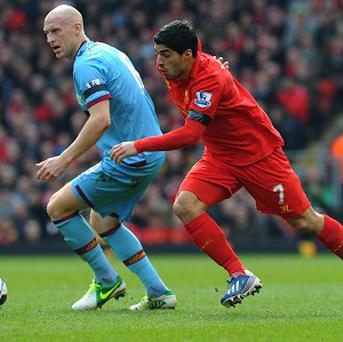 Luis Suarez, right, and James Collins compete for the ball