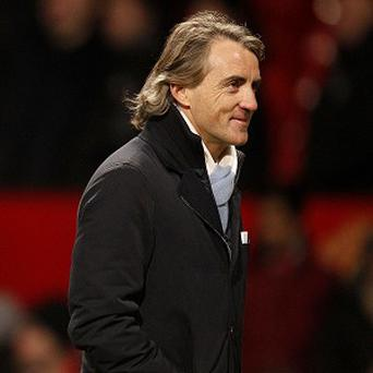 Roberto Mancini insists Manchester City simply cannot make up a 12-point gap