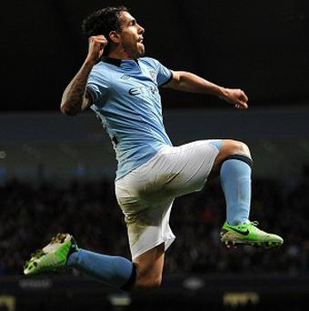 Manchester City's Carlos Tevez punches the air after finally breaking the deadlock against Wigan